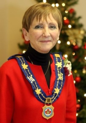 woman mayor wearing red blouse