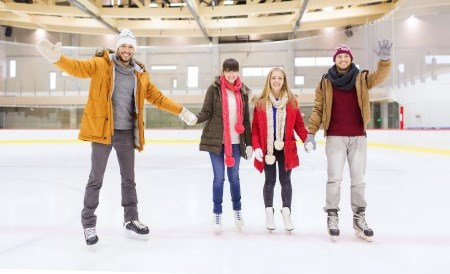 Group of young adults ice skating