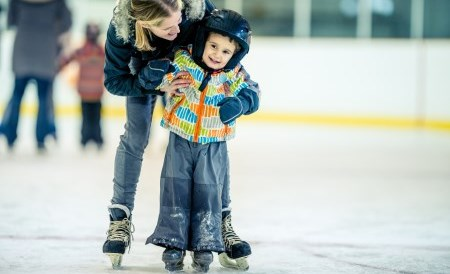 boy and mom on skating rink