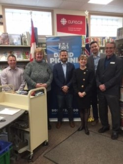 Mayor and dignitaries accepting a grant at the library